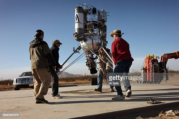 The Masten Space Systems tem lifts the rocket to the launch pad at Mojave Air and Space Port on Wednesday morning The team had two unsuccessful...