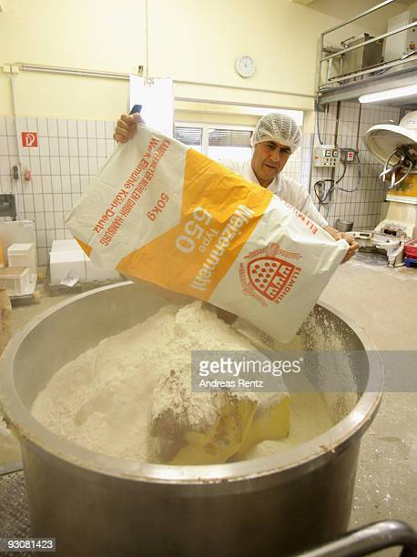 The master baker adds a sack wheat flour for the cookie dough in a huge bucket at the gingerbread bakery Henry Lambertz on November 13 2009 in Aachen...