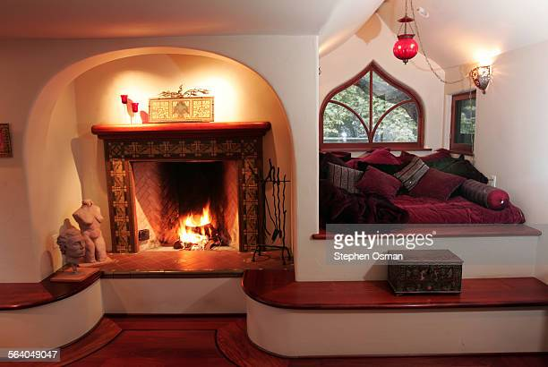 The master bedroom has a fireplace and a sitting area next to a window that looks out to the pool Architect Mark Whitman and his wife Julia own a...