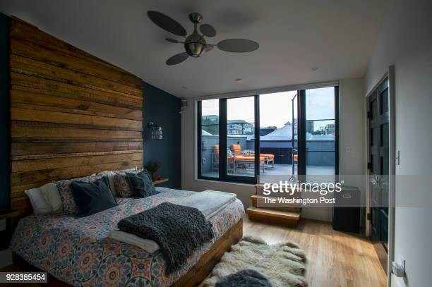 the master bedroom opening on to at roof top patio in Roshni Ghosh and Alaap Shah's 1892 row house in Shaw that was renovated into a family home for...