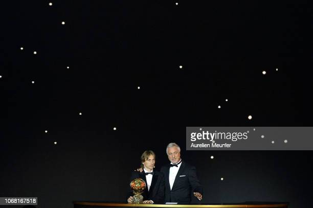 The master of ceremony David Ginola presents Luka Modric of Croatia and Real Madrid as he wins the 2018 Ballon D'Or at Le Grand Palais on December 3...