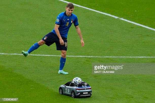 The match ball is delivered by a remote control car before the UEFA EURO 2020 semi-final football match between Italy and Spain at Wembley Stadium in...