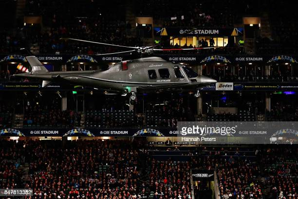 The match ball is delivered by helicopter head of the Rugby Championship match between the New Zealand All Blacks and the South African Springboks at...
