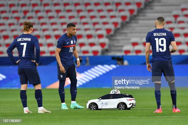 The match ball is delivered to Kylian Mbappe of France from a toy car ahead of the international friendly match between France and Wales at Allianz...
