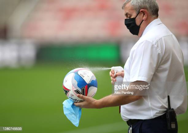 The match ball is disinfected prior to the Sky Bet Championship match between Middlesbrough and Reading at Riverside Stadium on October 17 2020 in...