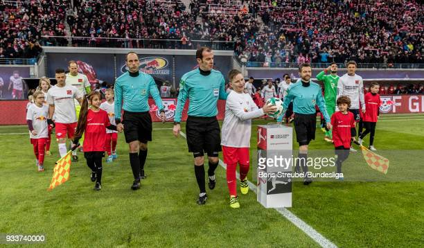 The match ball is taken by the ball kid prior to the Bundesliga match between RB Leipzig and FC Bayern Muenchen at Red Bull Arena on March 18 2018 in...