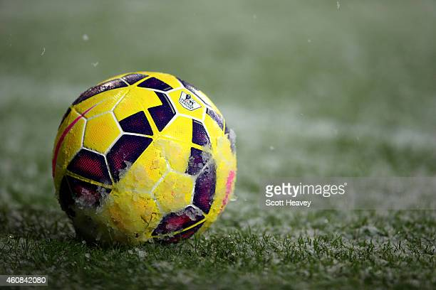 The match ball rests in the snow during the Barclays Premier League match between West Bromwich Albion and Manchester City at The Hawthorns on...