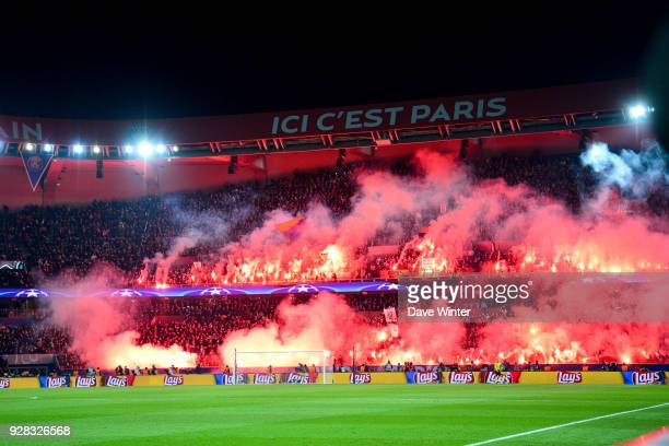 The match is held up after PSG fans light flares during the UEFA Champions League Round of 16 second leg match between Paris Saint Germain and Real...