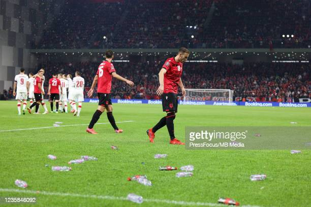 The match is suspended because of fans throwing objects onto the pitch during the 2022 FIFA World Cup Qualifier match between Albania and Poland at...