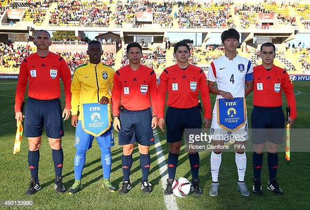 The match officials and team captains line up for the FIFA U17 World Cup Group B match between Brazil and the Korea Republic at Estadio Francisco...