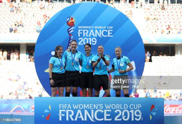 The match officials celebrate with their medals following the 2019 FIFA Women's World Cup France 3rd Place Match match between England and Sweden at...