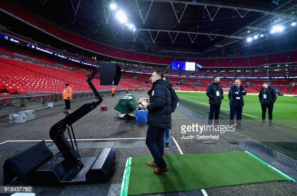 The match officials check the VAR system pitchside prior to The Emirates FA Cup Fourth Round Replay match between Tottenham Hotspur and Newport...