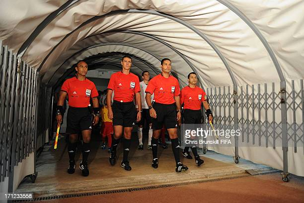 The match officials lead out the teams ahead of the FIFA U20 World Cup Group E match between England and Iraq at Akdeniz University Stadium on June...