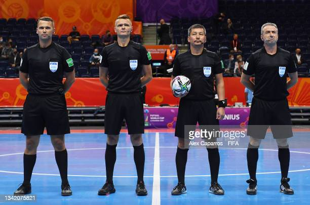 The match officials line up prior to the FIFA Futsal World Cup 2021 Round of 16 match between Argentina and Paraguay at Vilnius Arena on September...