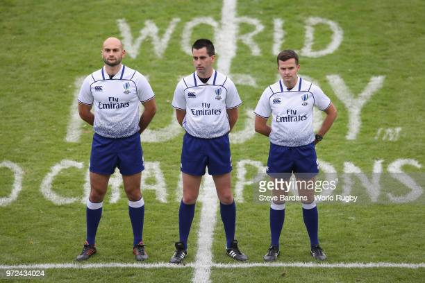 The Match officials Ludovic Cayre Sean Gallagher and Andrea Piardi line up prior to the 9th Place semi final match between Georgia and Japan at Stade...
