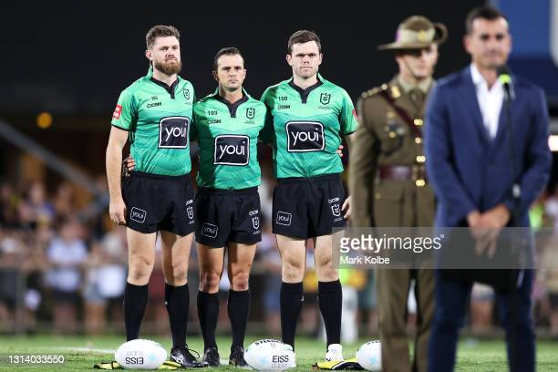 The match officials pause during an ANZAC ceremony before the round seven NRL match between the Parramatta Eels and the Brisbane Broncos at TIO...