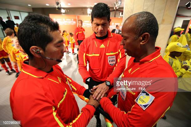 The match officials referee Oscar Ruiz of Colombia and assistants Humberto Clavijo and Abraham Gonzalez pray before the 2010 FIFA World Cup South...