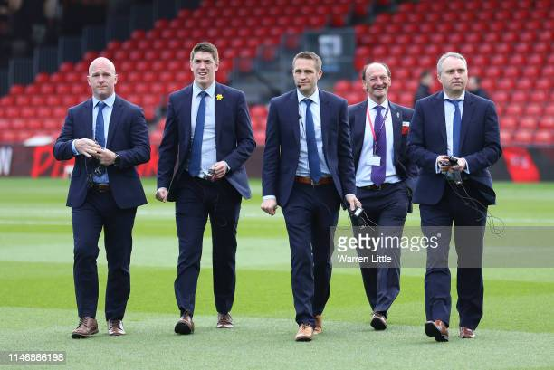 The match officials take a look around the pitch prior to the Premier League match between AFC Bournemouth and Tottenham Hotspur at Vitality Stadium...
