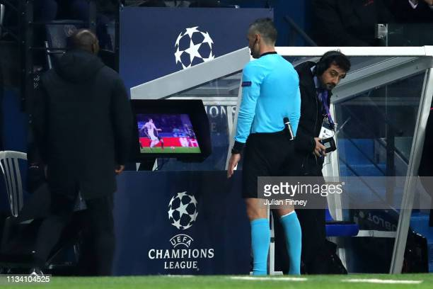 The match referee checks the VAR system before awarding a penalty in favor of Manchester United during the UEFA Champions League Round of 16 Second...
