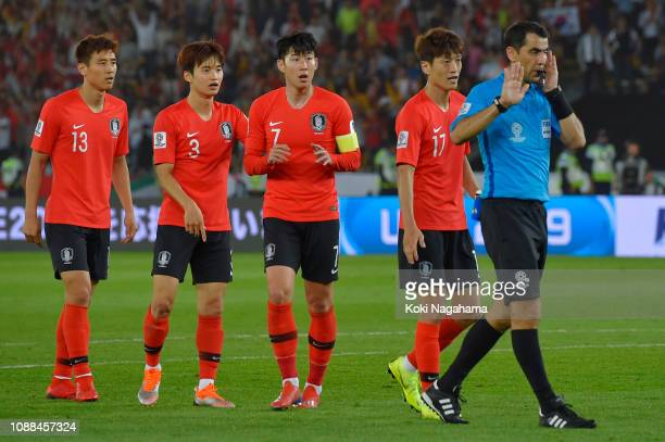 The match referee checks VAR during the AFC Asian Cup quarter final match between South Korea and Qatar at Zayed Sports City Stadium on January 25...