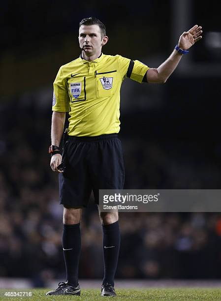 The match referee Michael Oliver gives a decision during the Barclays Premier League match between Tottenham Hotspur and Swansea City at White Hart...