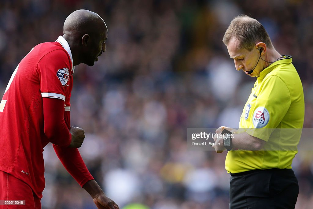 The match referee writes a penalty to Alou Diarra of Charlton Athletic FC (not pictured) after his tackle against Chris Wood of Leeds United (not pictured) during the Sky Bet Championship match between Leeds United and Charlton Athletic at Elland Road on April 30, 2016 in Leeds, United Kingdom.