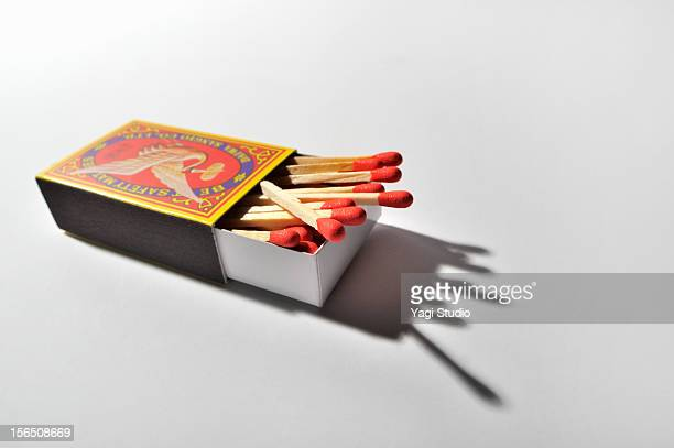 the match which is in the pack of matches - fiammifero foto e immagini stock