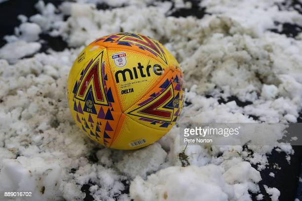 The matchball is seen in snow surrounding the pitch during the Sky Bet League One match between Oldham Athletic and Northampton Town at Boundary Park...