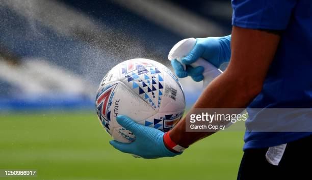 The matchball is sprayed with disinfectant during the Sky Bet Championship match between Huddersfield Town and Wigan Athletic at John Smith's Stadium...