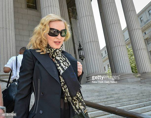 The Material Girl Madonna leaves Manhattan Supreme Court after showing up for jury duty was flanked by a security entourage as she entered into the...