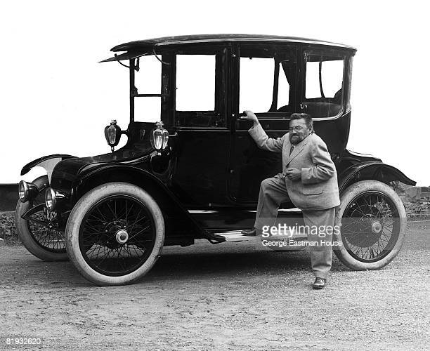 The mathematician and electrical engineer Charles Proteus Steinmetz standing beside a Detroit Electric touring automobile produced by Detroit's...