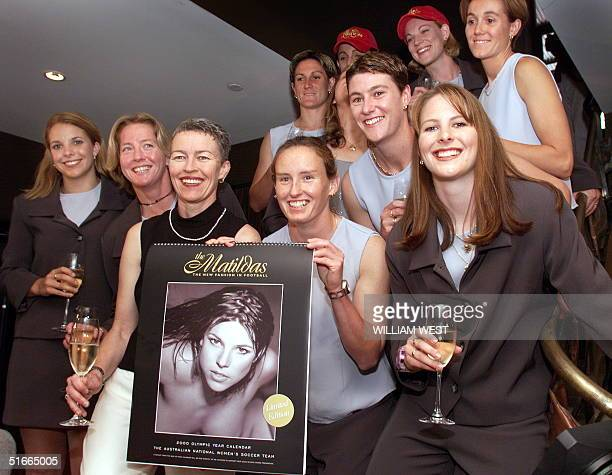 The Matildas' Australia's women's soccer team poses with a nude calendar produced to promote women's soccer in Australia in Sydney 30 November 1999...