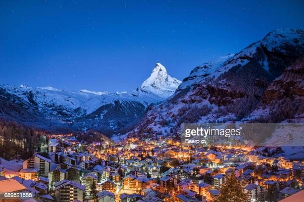 The Matterhorn mountain peak over Zermatt city at night, Switzerland.