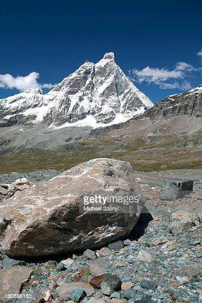 The Matterhorn (Monte Cervino) with rocks in the foreground, Breuil-Cervinia, Valtournenche, Aosta, Italy