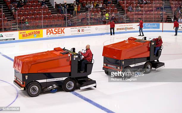 The Matthews Arena rink staff tows a Zamboni ice resurfacer off the ice after it broke down between the second and third periods of an NCAA hockey...