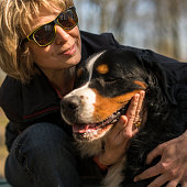 http://www.istockphoto.com/photo/the-mature-50-years-old-attractive-woman-embracing-the-bernese-mountain-dog-gm678954608-124466627