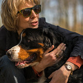 http://www.istockphoto.com/photo/the-mature-50-years-old-attractive-woman-embracing-the-bernese-mountain-dog-gm695293672-128537461