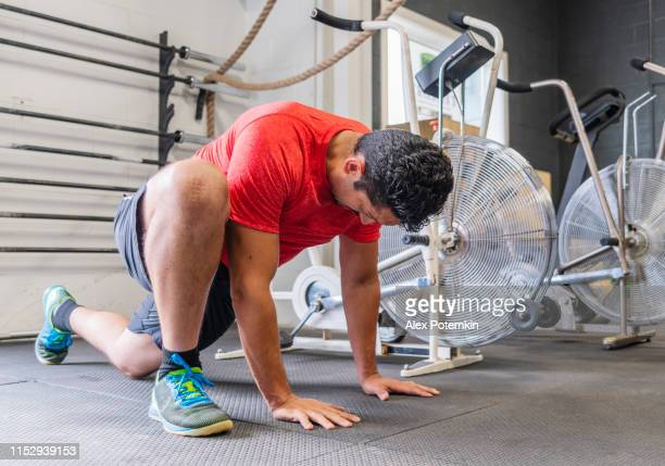the mature hispanic latino man doing fitness exercise, pushup, and climbing, in the gym. - alex potemkin or krakozawr latino fitness stock photos and pictures