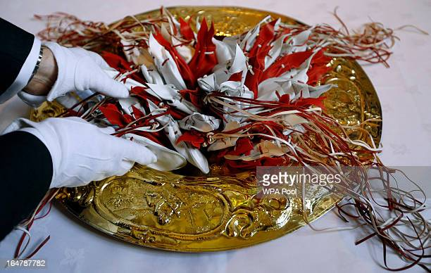 The Maundy purses are arranged on a gold plate ready for distribution by Queen Elizabeth II during the Maundy service, at Christ Church Cathedral on...