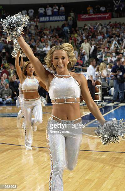 The Mavs Dancers entertain the fans during the NBA game between the Golden State Warriors and the Dallas Mavericks at American Airlines Center on...