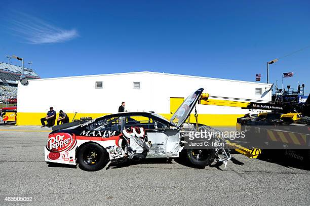 The MAXIM Fantasy App/Dr Pepper Toyota is towed through the garage during qualifying for the 57th Annual Daytona 500 at Daytona International...