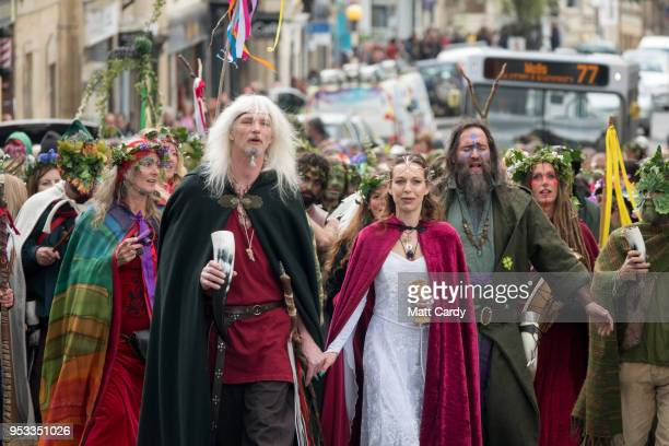 The May Day 'King' and Queen' lead the Greenmen of Glastonbury carrying this year's Maypole through the centre of Glastonbury to a ceremony at Bushy...