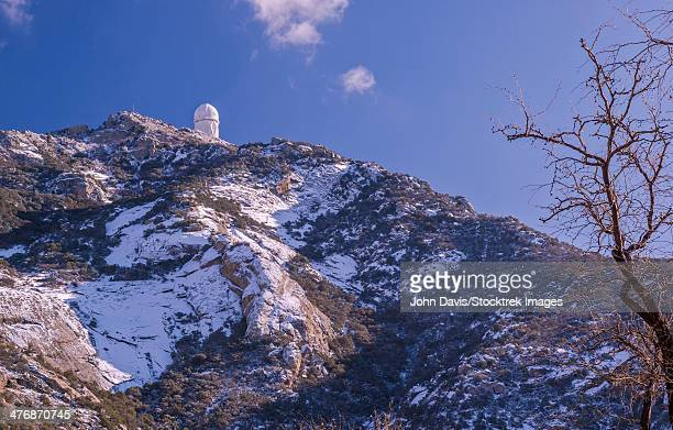 The Mayall Observatory stands on Kitt Peak in this winter scene near Tucson, Arizona.