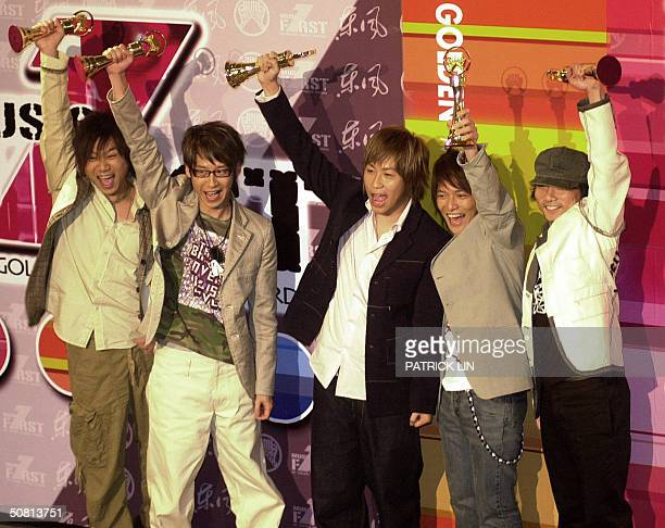The MAYDAY display their best male vocal performance awards at the 15th annual Golden Melody Awards in Taipei 08 May 2004 The Golden Melody Awards...