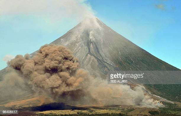 The Mayon volcano pictured from the city of Legazpi in Albay province 330 kms southeast of Manila on December 27 2009 spews pyroclastic ash into the...