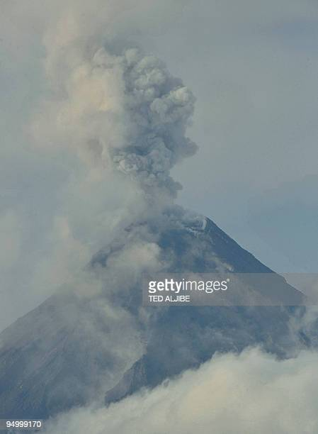 The Mayon volcano spews ash into the air as seen from the city of Legazpi in Albay province on December 22 2009 Mount Mayon sprayed volcanic ash over...