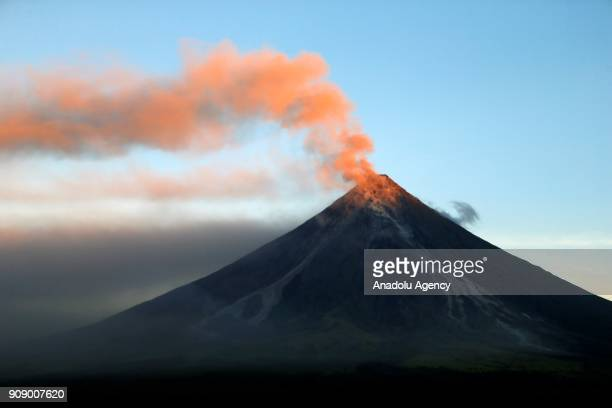 The Mayon volcano spews ash kilometers away into the air in Daraga Albay Philippines on January 23 2018 Disaster officials were placed on red alert...
