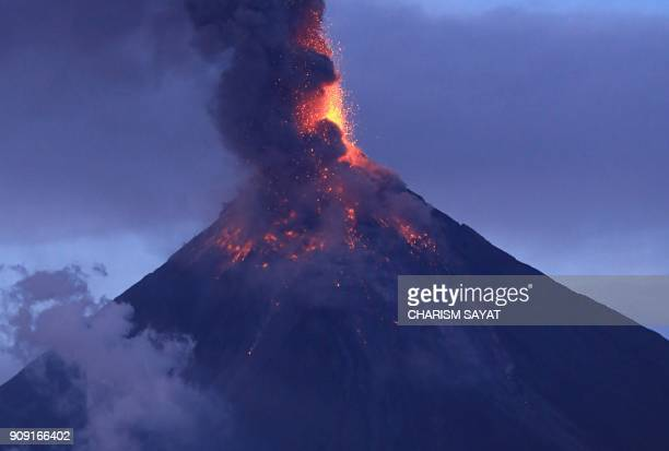 The Mayon volcano spews lava as it continues to erupt as seen from Legazpi City in Albay province south of Manila on January 23 2018 Intense lava...