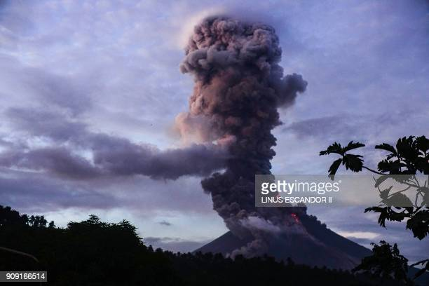 TOPSHOT The Mayon volcano spews lava as it continues to erupt as seen from Daraga town in Albay province south of Manila on January 23 2018 Intense...