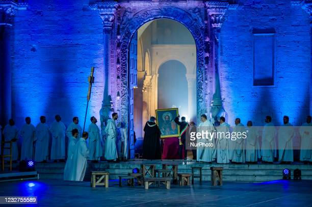 The Mayor Antonio De Caro puts the painting of San Nicola back in the Basilica at the end of the show on the occasion of the Feast of San Nicola in...